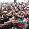 Au escaladat gardul de sârmă ghimpată la frontiera dintre Maroc şi Spania, la Ceuta