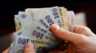 Salariul mediu net a scăzut cu 14 lei