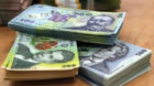 Guvernanţii susţin că au bani de pensii şi salarii