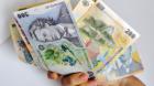 Românii îşi chetuie cea mai mare parte a banilor pe mâncare şi impozite